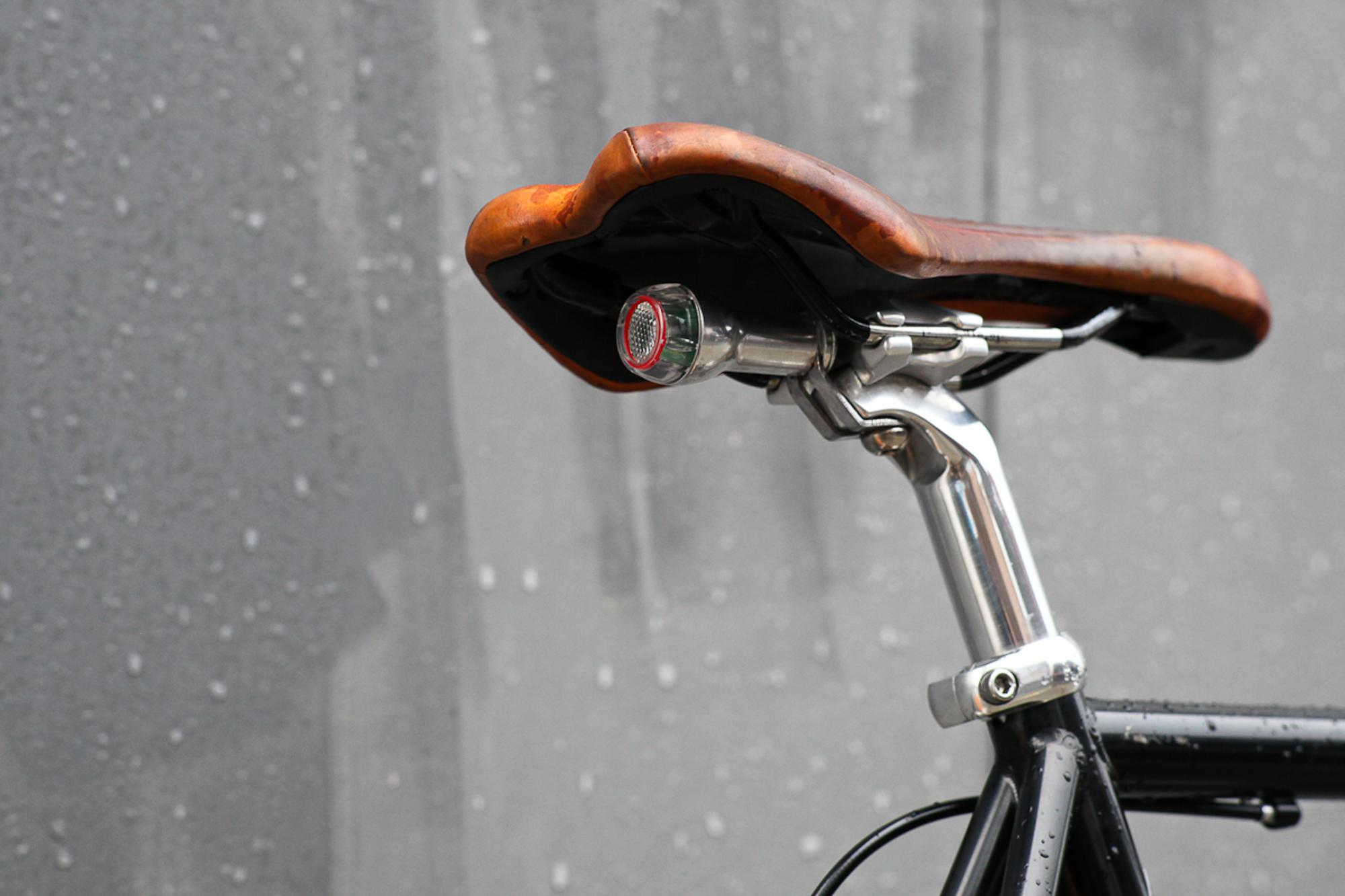 The rear light's casing was stripped of its black anodizing and polished, only then could it be mounted to the bracket, attached to the seat post.