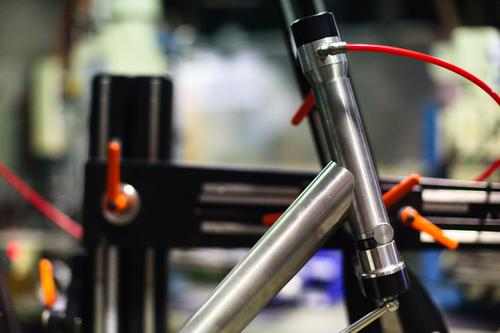 The downtube is mitred and placed against the head tube.