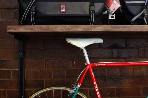 Museum-quality bikes line the shelves.