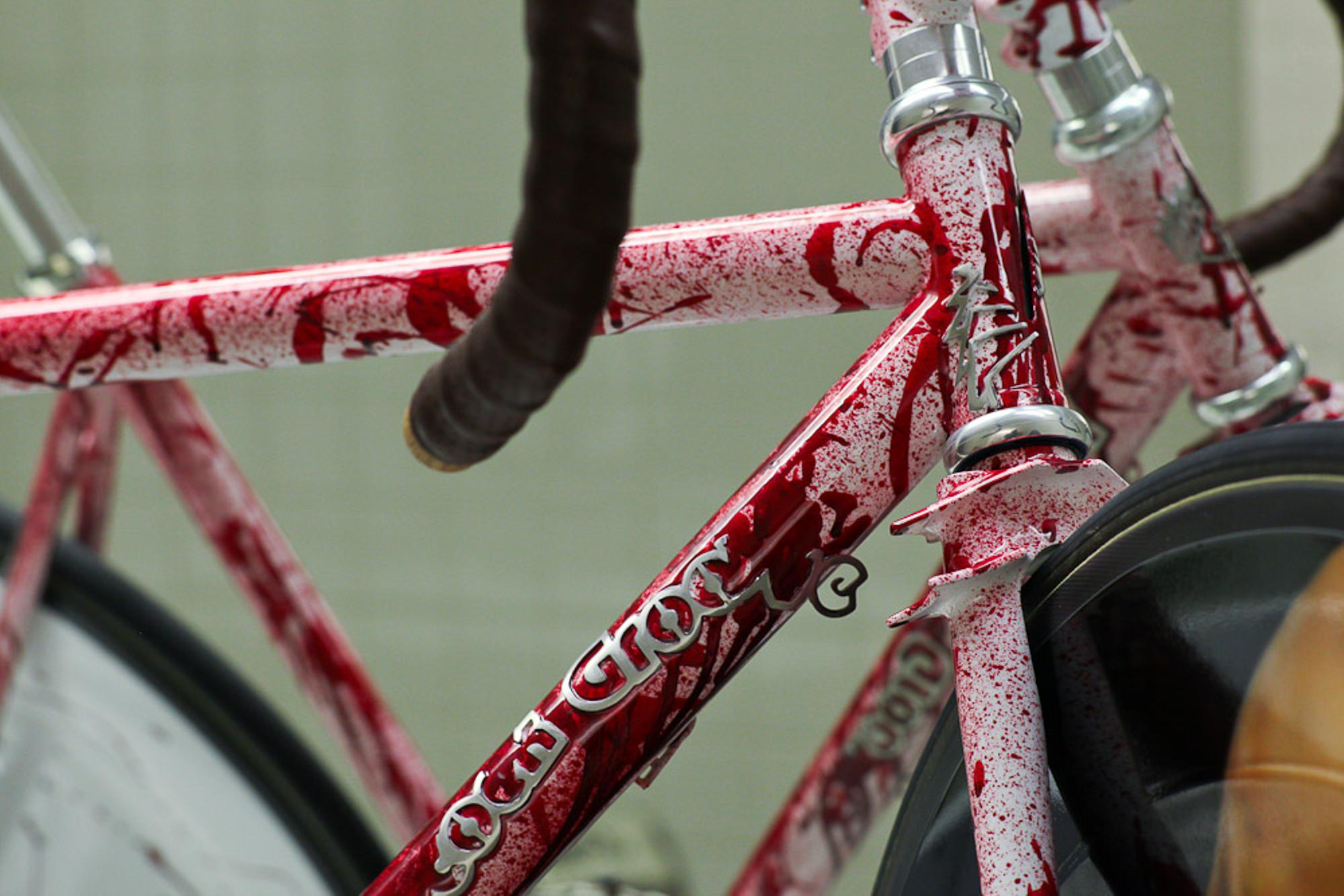 Blood splattered, wrecked downtube.