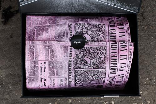 The pink newsprint that's made its way into all the Rapha stores hides the contents.