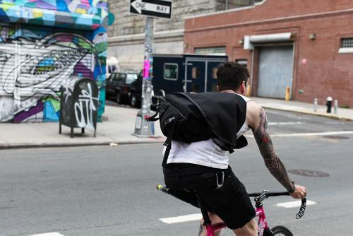 Messenger bag, covering his back, he knew how to ride, it was his knack.