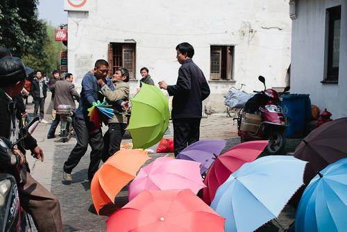 Here, an umbrella vendor chokes a building owner who was upset that he was selling umbrellas in front of his building.