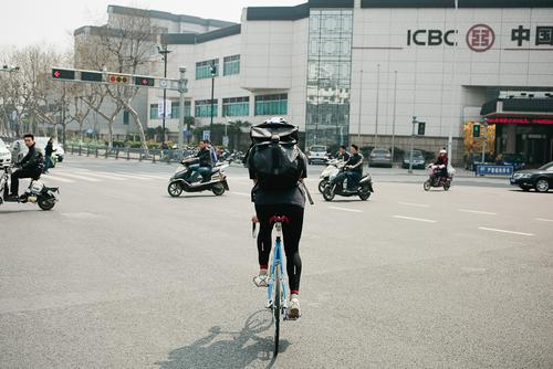 Turn signals in China mean nothing, cars go through cross walks, scooters run reds.