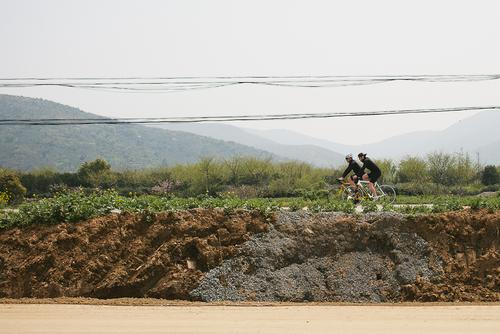 I hopped off the road, into this construction site, to get a photo of Lyle and Drew riding.