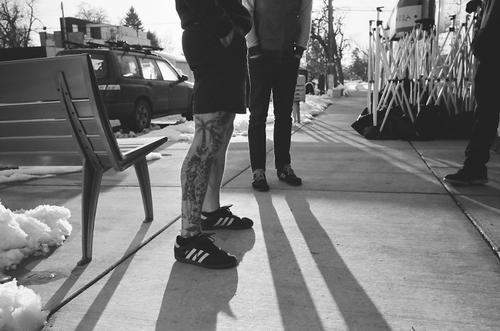 Bare legs, long shadows.