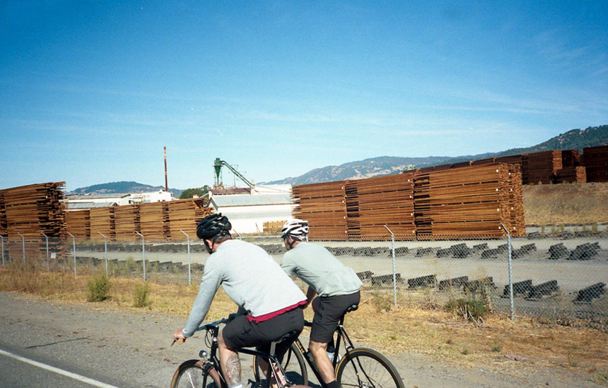 Riding past lumber yards.