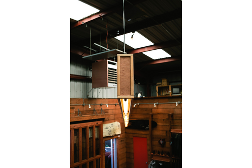 A new lighting fixture hangs below the skylights.
