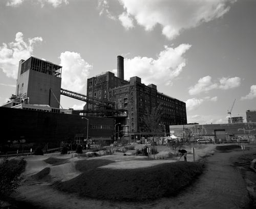The Brooklyn Bike Park sits adjacent to the shut down Domino Sugar factory.