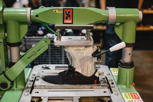 Chrome's WWII-era German boot maker. This machine molds the outsole to the sole.