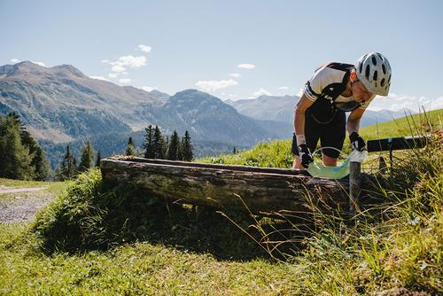 At the top of a climb, Stephan fills up his Hydropack.