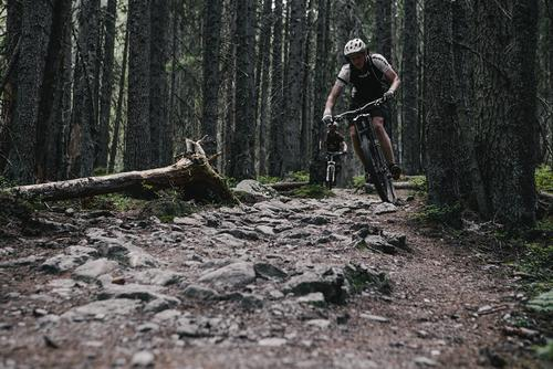 Down the mountain and into rocky and steep singletrack. Stefan and his form.