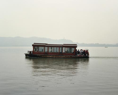 Vehicles 05 - A sightseeing barge, in a tourist-heavy town. This lake is regarded as beautiful. That's not fog.