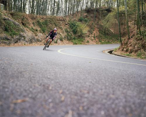 Roads 05 - Jeff cornering from the bamboo forest mountains.