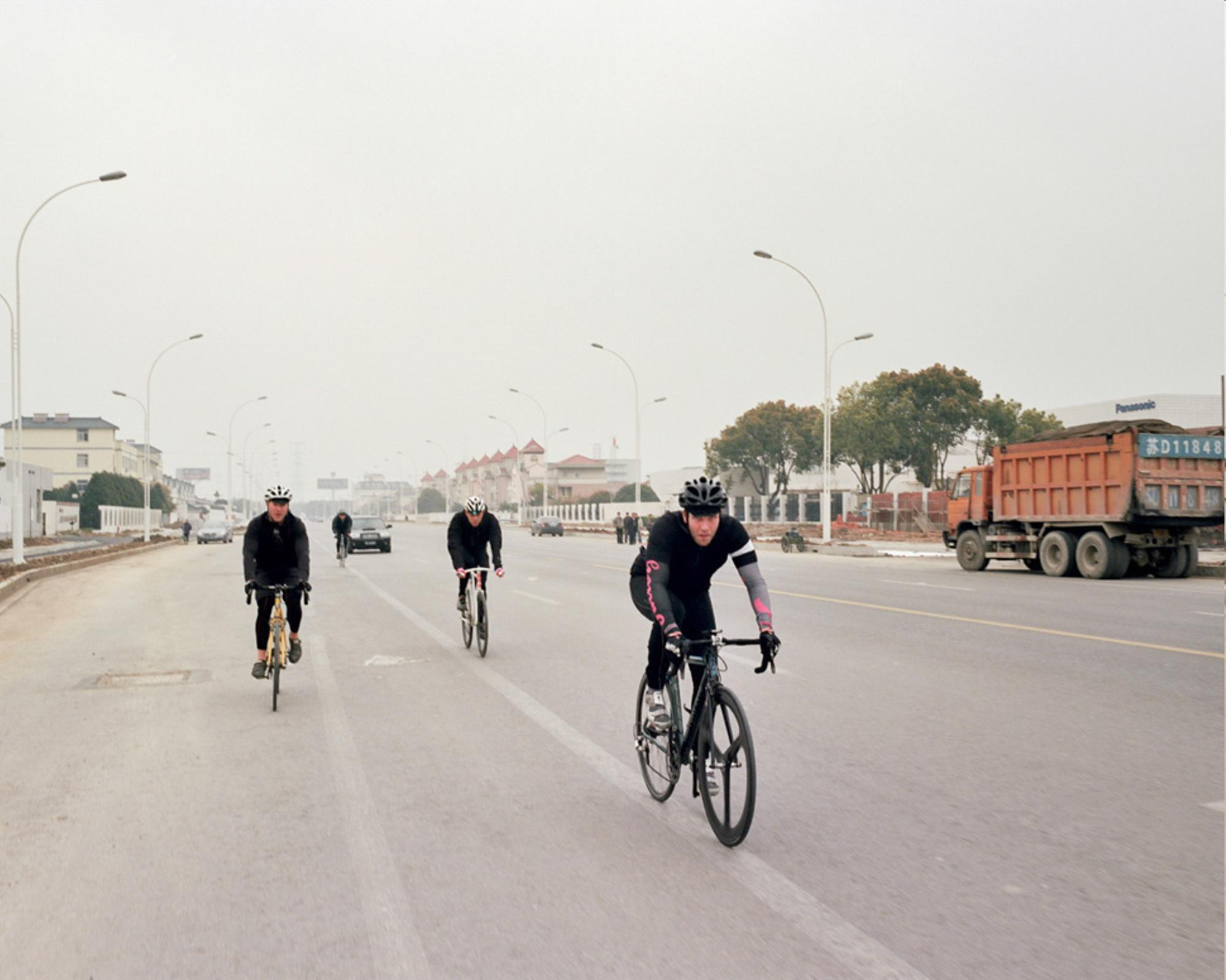 Shot from a Moving Bicycle 01 - The group often broke apart in the heavily polluted areas. You had to concentrate on breathing.