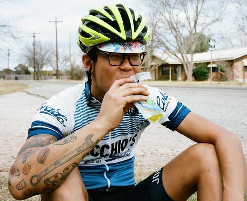 Chris, eating a pickle, one of the best mid-ride snacks.