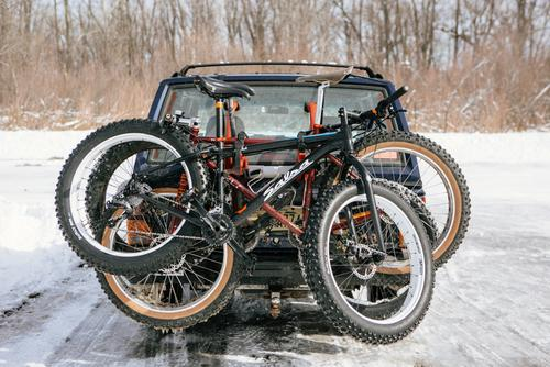 Three fatbikes on a rack that specifies max bike weight 30lbs...