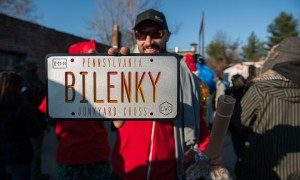 A racer proudly displayed his trophy from the 2014 Bilenky Junkyard Cross race.