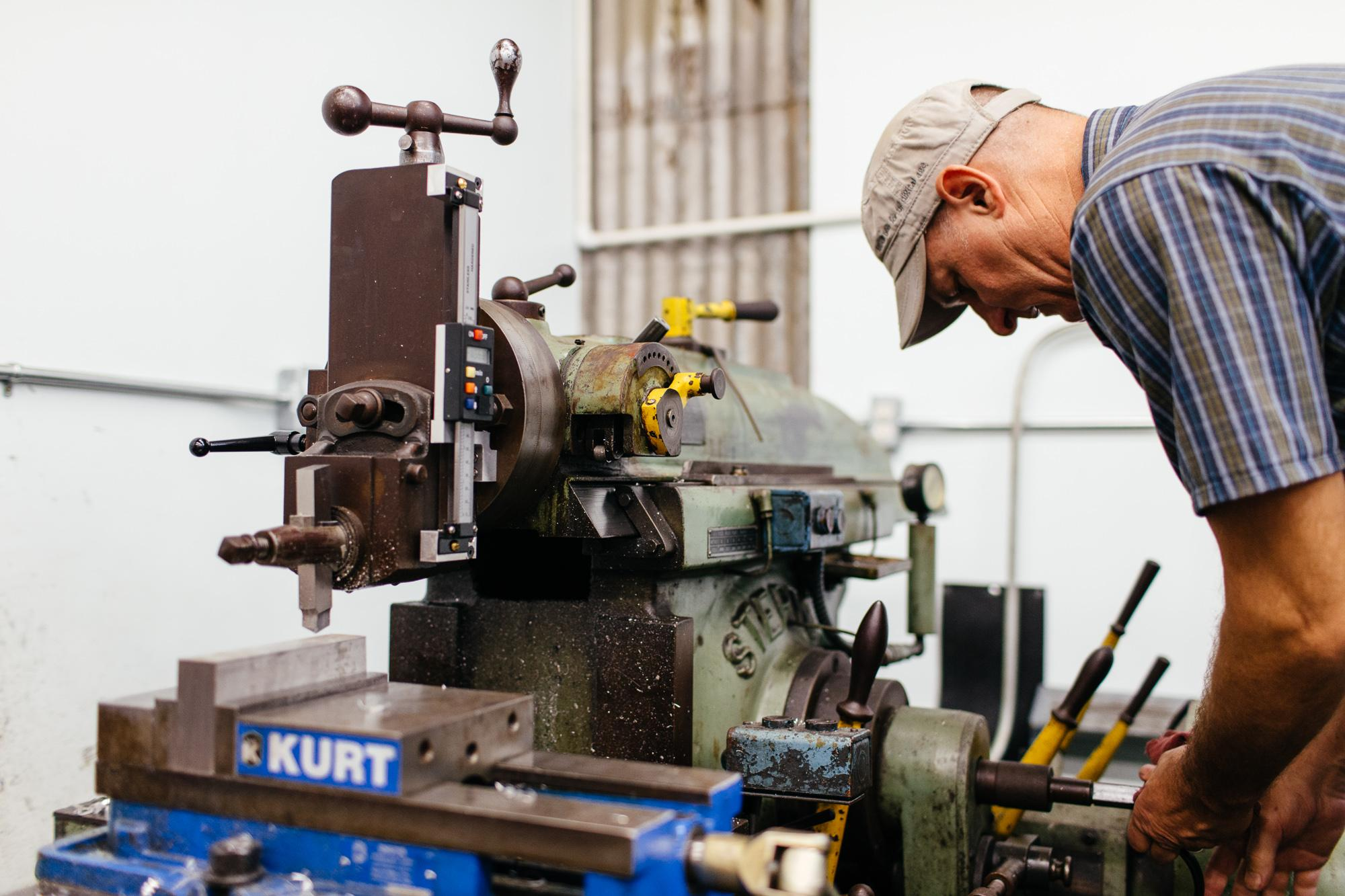 Paul, working on his shaper, a machine from WWII era production