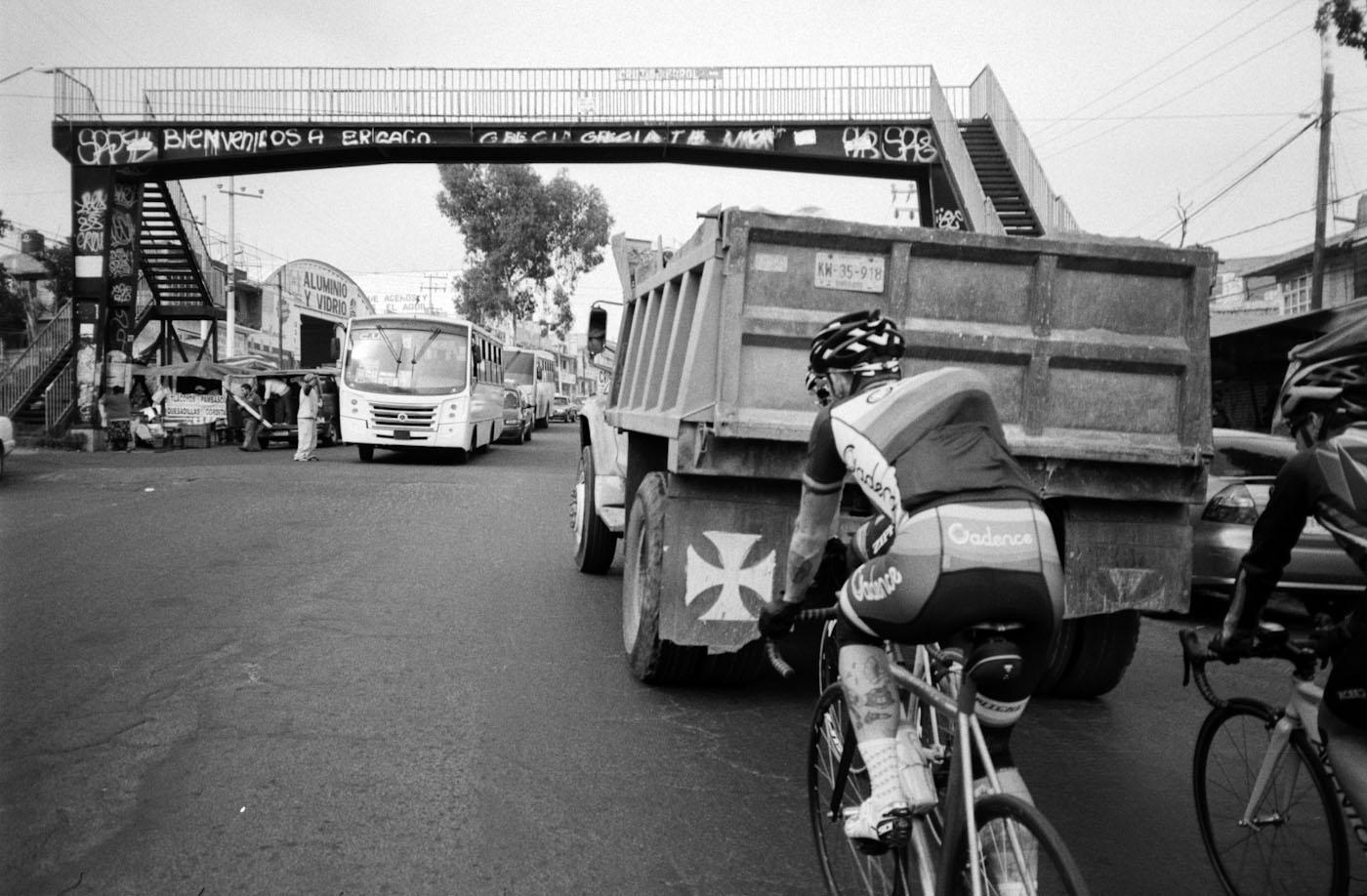 the first section of the Ajusco climb was heavily trafficked with trucks and buses in a low gear, barely making it up the steep incline