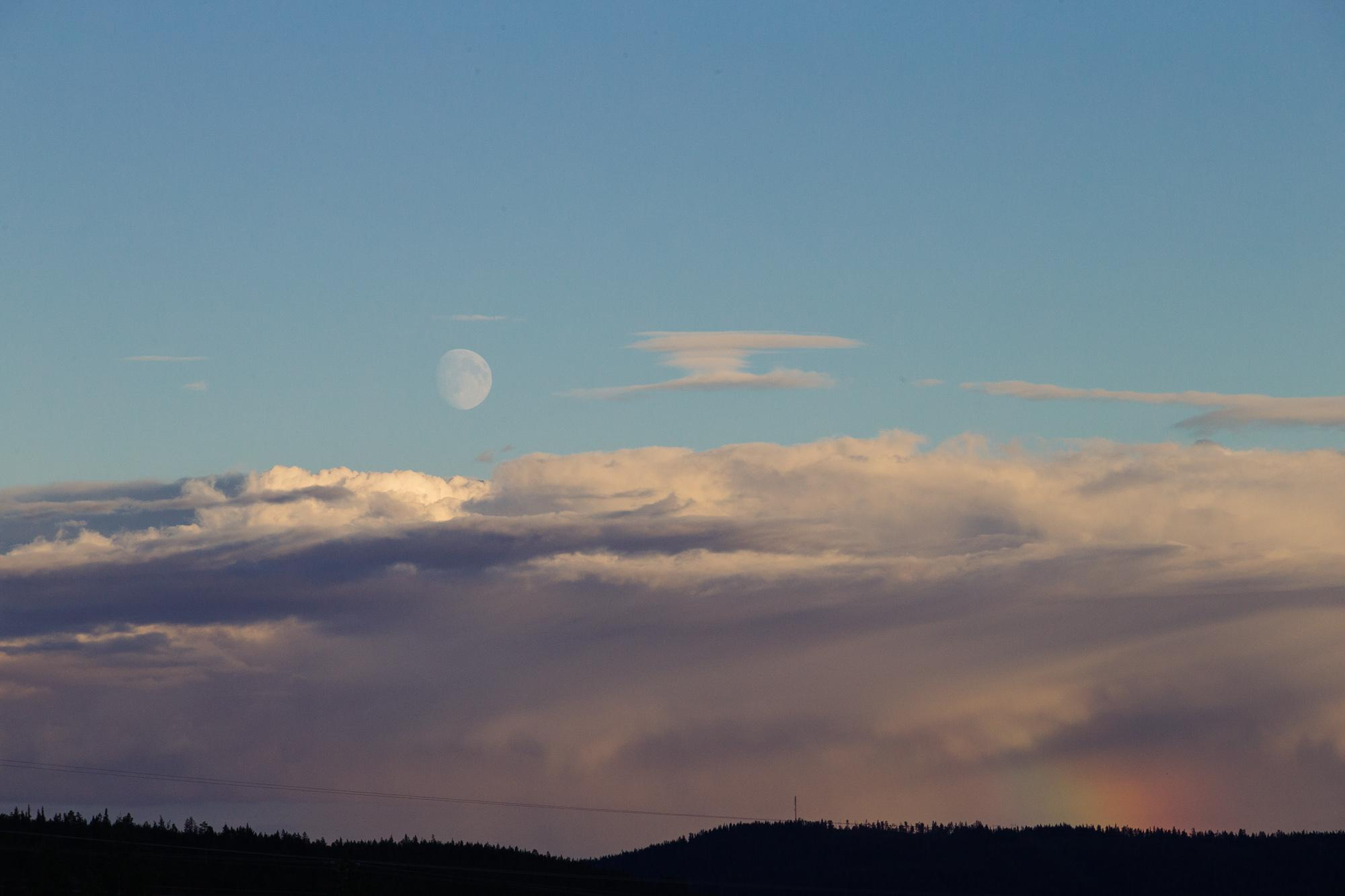 Moon, cloud bank, rainbow.