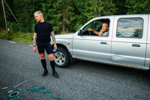 Concerned motorist while Erik performs spoke surgery.
