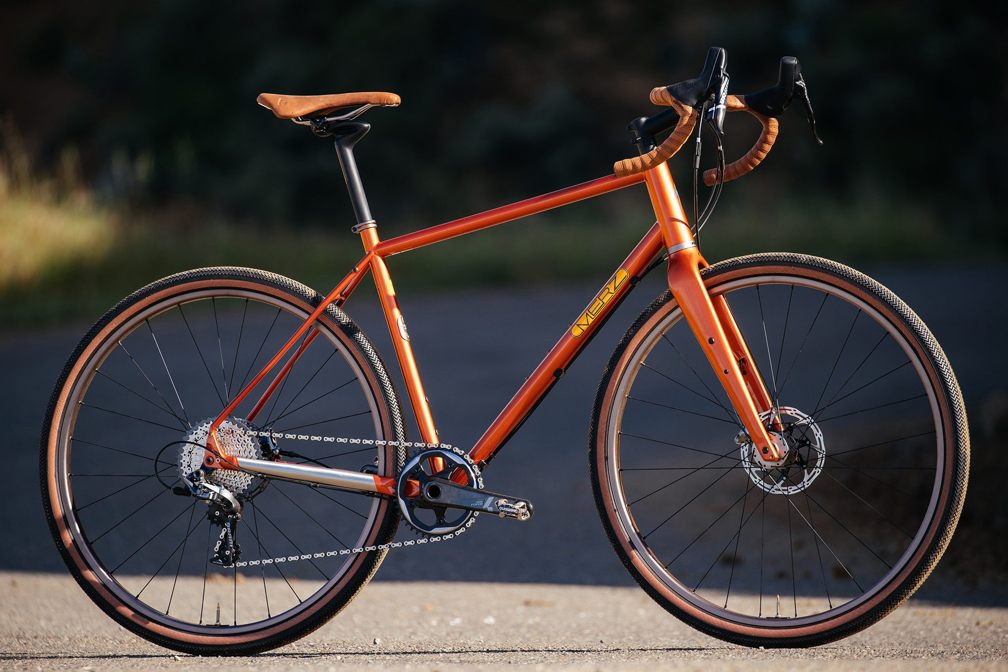"""b18040f5ff7 These bikes come in a vibrant """"Valencia Orange"""" with metallic fleck. The  Cruzero wheels, headset and seat clamp has a special, custom anodization."""