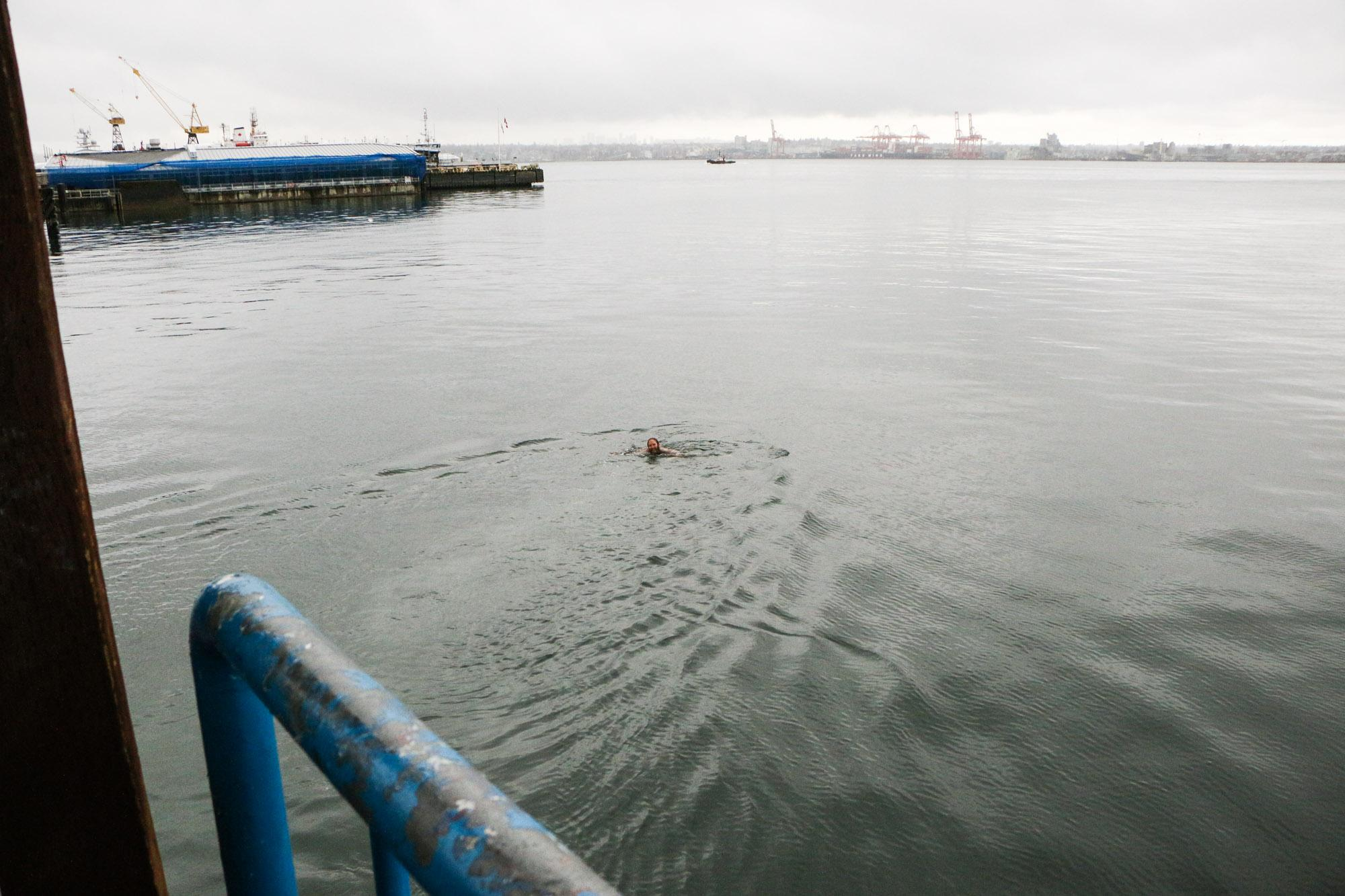 By the time he swam out, the mug had already made it pretty far into Burrard Inlet.