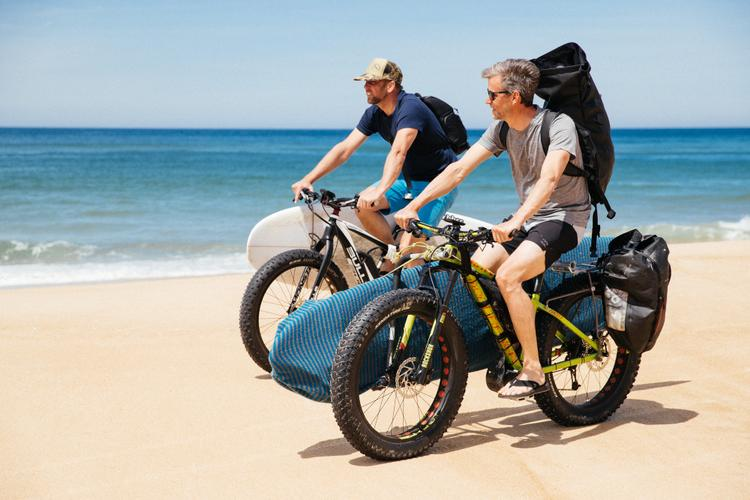 Riding e-Fatbikes on the Beach to go Surfing in France