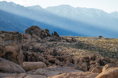 Biotite monzogranite boulders and jagged Sierra Nevada.