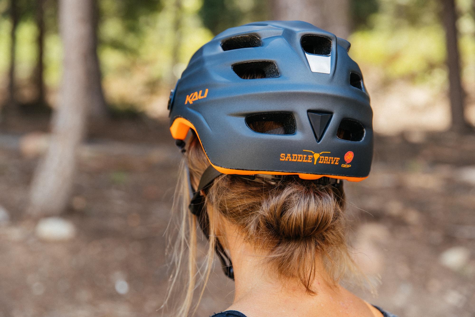 Crystal modeling the Kali Saddle Drive Helmet