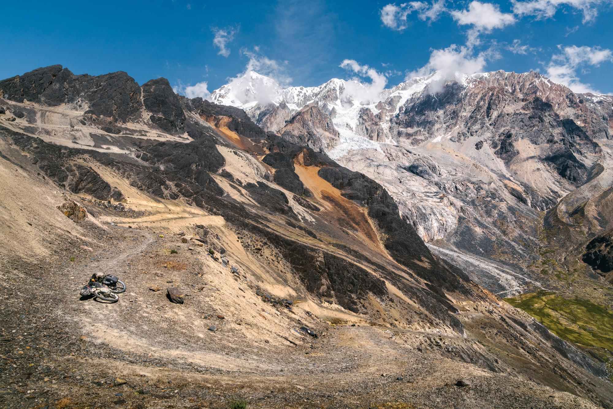 Climbing abandoned mining roads toward Illimani
