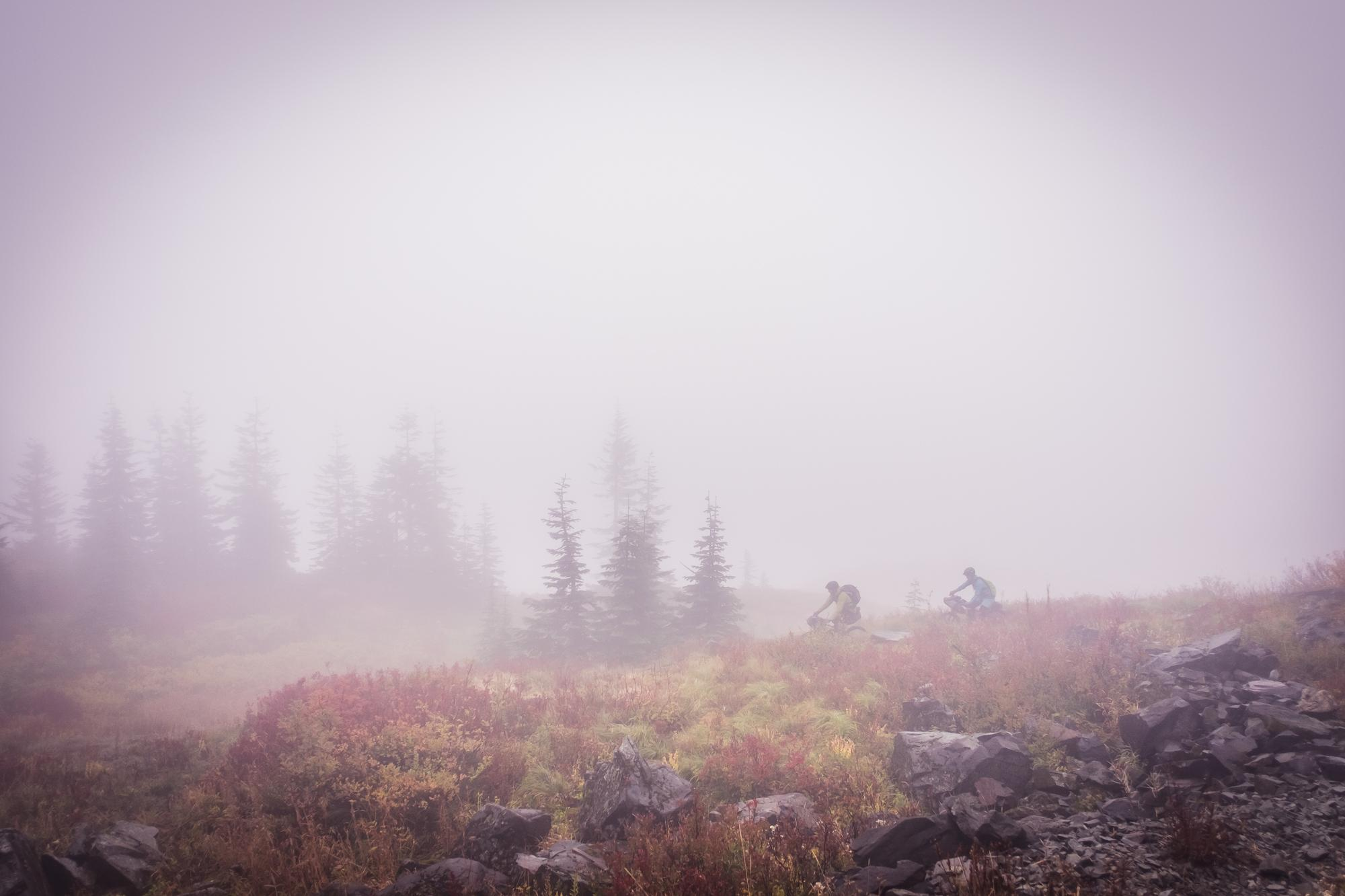 The clouds had engulfed us overnight, we left camp into an unknown world.