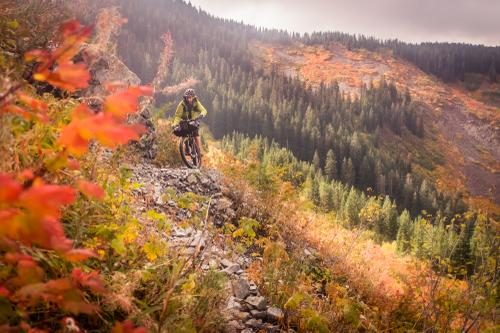 Riding the scree fields in fall colors as the sun burned through the rain clouds was otherworldly.