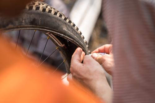 Sewing a bead back onto a tire
