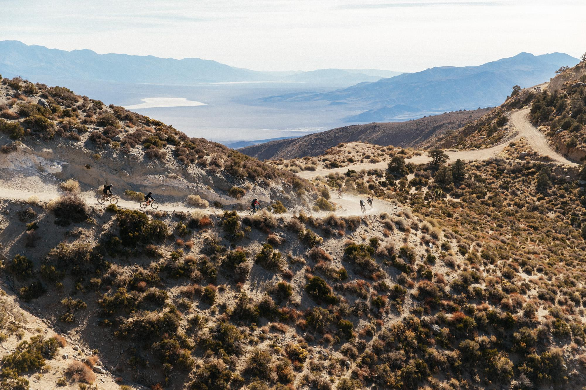 Panamint Valley in the background, stoked riders in the foreground.