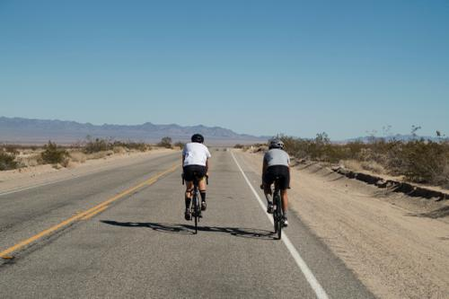 Lael rides alongside Rugile on route to the rest stop. (Trevor Raab)
