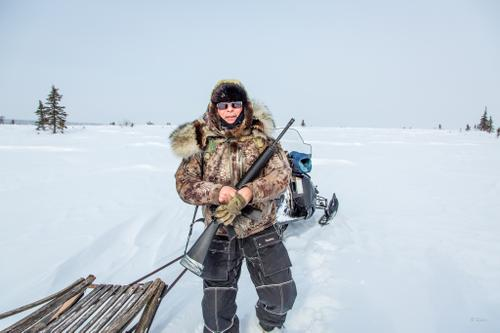 An Inupiaq hunter from Koyuk Village takes a break while out hunting caribou.