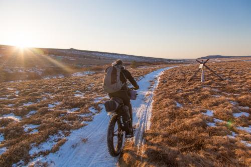 Kim McNett rides a trail over frozen tundra outside Unalakleet Village.