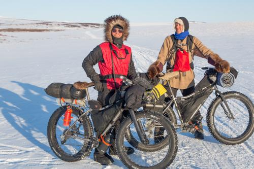 Bjørn Olson and Kim McNett crossing the Seward Peninsula on their 2014 Fat-Bike to the Arctic expedition. The couple became the first people to bike from Anchorage to Kotzebue.