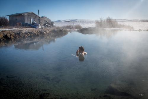 Kim McNett soaks in a natural hot spring on the Seward Peninsula. The inupiat have been using these natural hot springs for thousands of years.