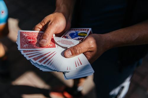 Handing out cards.