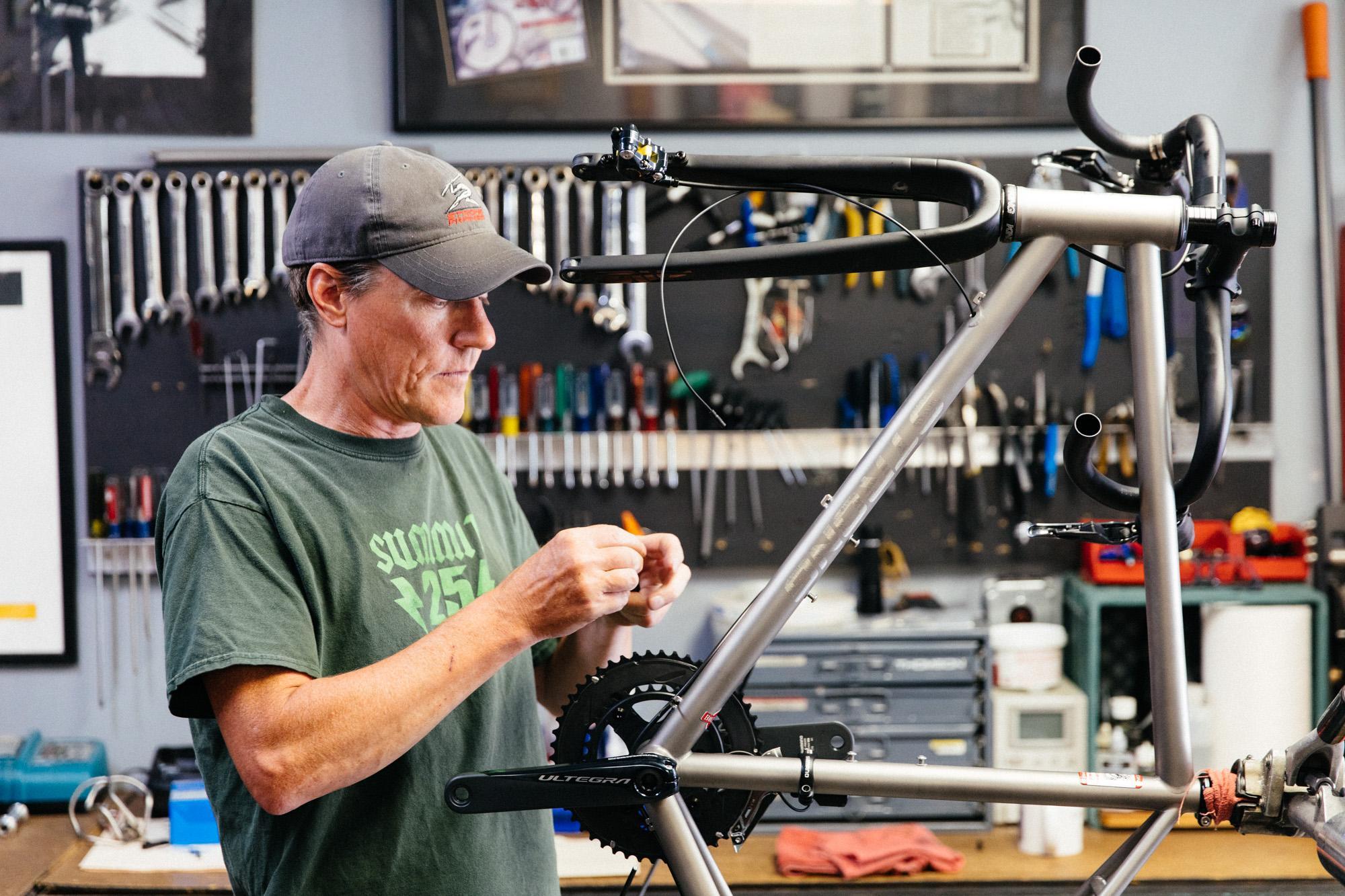 Carl building bikes.
