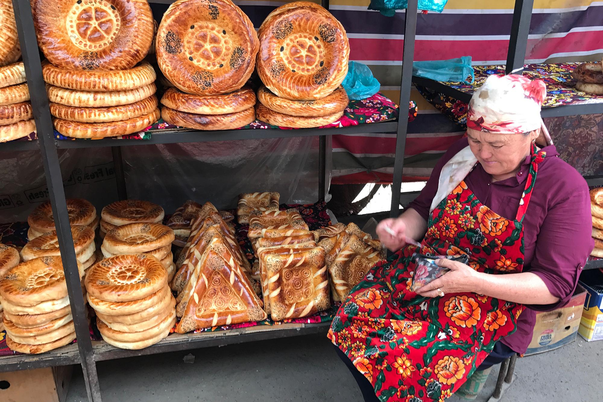 Called 'non' or 'nan,' the traditional bread in Central Asia is decorated with a bread stamp called a 'chekich.' The bread is then cooked in an oven called 'tandyr' (similar concept to a tandoor oven), slapping the dough directly onto the oven walls.