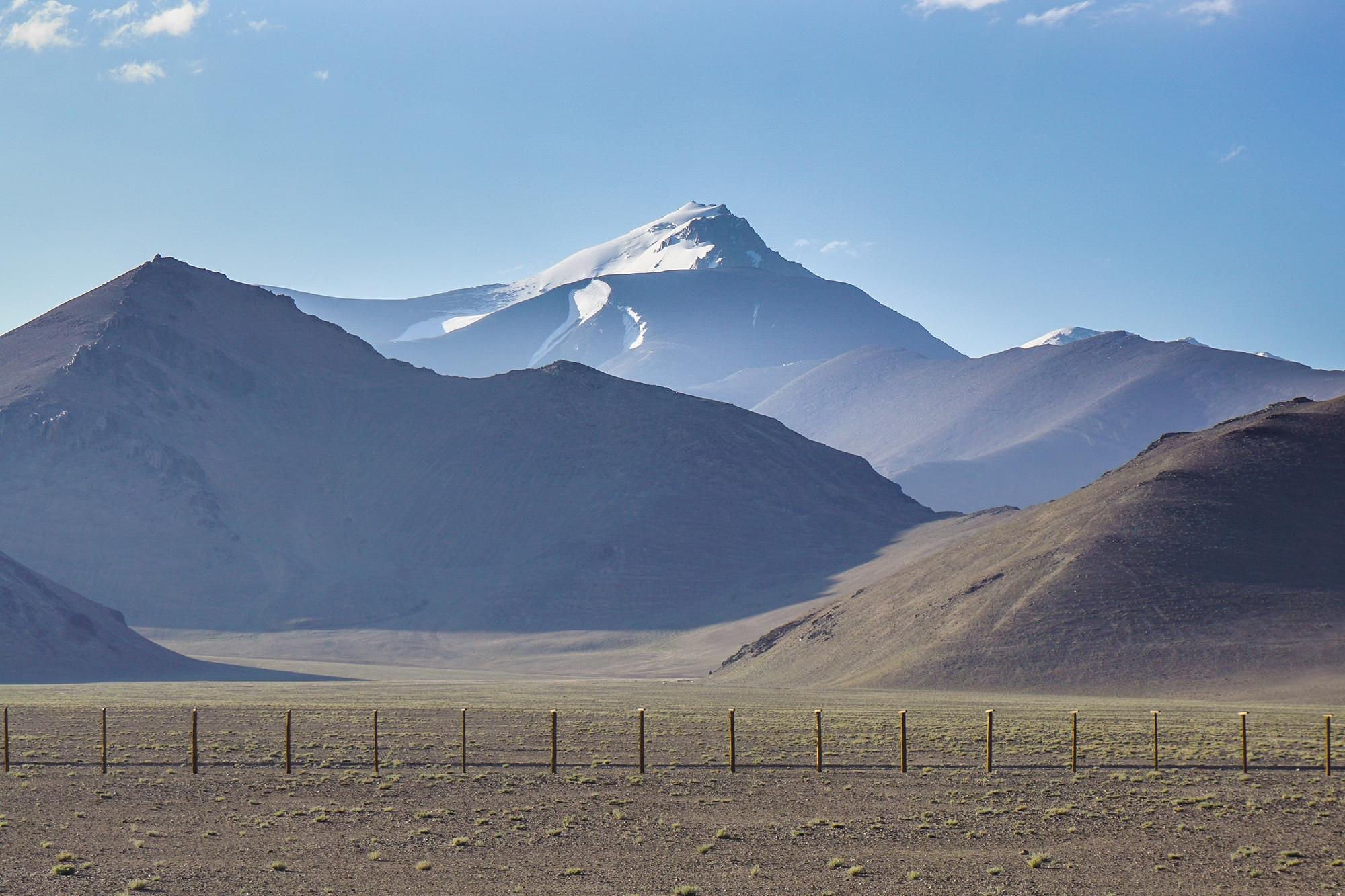 The new Chinese border fence with the Sarykol Range of the Pamirs just beyond.