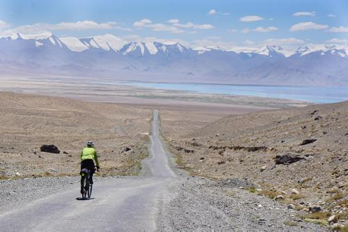 Descending into Karakul on the shores of a briney lake of the same name.
