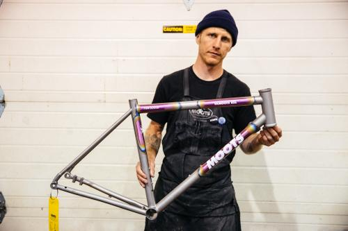 Bret holding an in-process frame.
