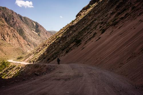 We make our way along the red sand roads to Kyzyl-Oi