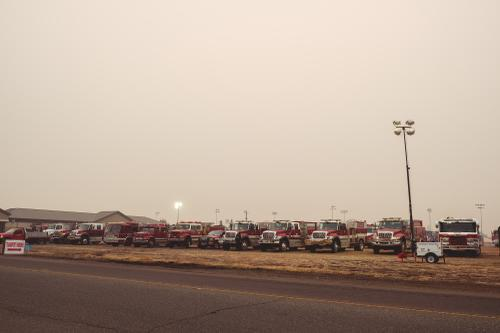 Parking lot at the fairgrounds full of fire trucks
