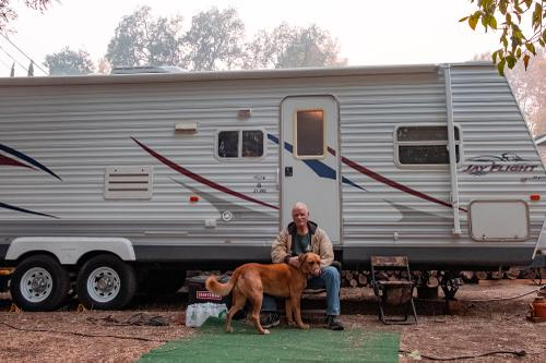 Tommy is living in a borrowed RV in a backyard